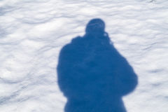 Photographer shadow on the snow Stock Images