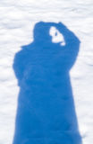 Photographer shadow on the snow Stock Photography