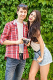 Photographer shooting beautiful brunette model near green wall royalty free stock photos