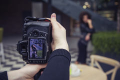 Photographer shooting a beautiful brunette woman on a walk on eu Stock Photos