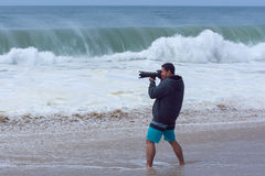 Photographer shooting big surf at California beach Royalty Free Stock Photography