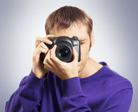 Photographer shooting by camera Stock Photo