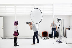 Photographer shooting fashion model in photo shoot royalty free stock photo