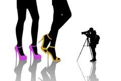 Photographer shooting fashion women. Photographer shooting the shoes of young beautiful fashion women with long legs Royalty Free Stock Photos