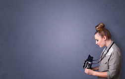 Photographer shooting images with copyspace area Royalty Free Stock Images
