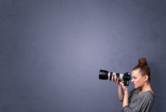 Photographer shooting images with copyspace area Royalty Free Stock Photography