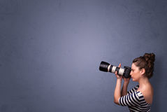 Photographer shooting images with copyspace area Stock Photos