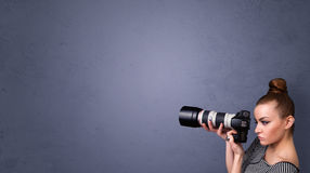 Photographer shooting images with copyspace area Stock Images