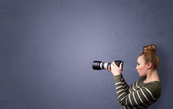 Photographer shooting images with copyspace area Royalty Free Stock Image
