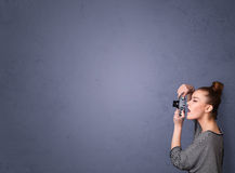 Photographer shooting images with copyspace area Royalty Free Stock Photo
