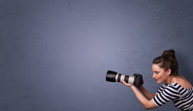 Photographer shooting images with copyspace area Royalty Free Stock Photos