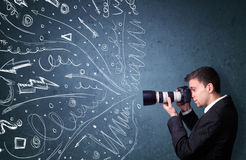 Photographer shooting images while energetic hand drawn lines an Stock Images