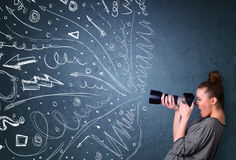 Photographer shooting images while energetic hand drawn lines an Stock Photos