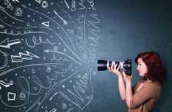 Photographer shooting images while energetic hand drawn lines an Stock Image