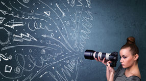 Photographer shooting images while energetic hand drawn lines an Royalty Free Stock Photo