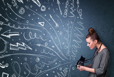 Photographer shooting images while energetic hand drawn lines an Stock Photography