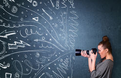 Photographer shooting images while energetic hand drawn lines an Royalty Free Stock Images