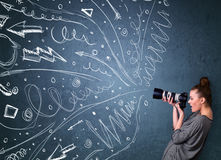 Photographer shooting images while energetic hand drawn lines an Royalty Free Stock Image