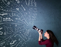 Photographer shooting images while energetic hand drawn lines an Royalty Free Stock Photography