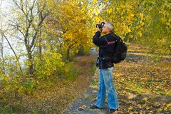 Photographer shooting landscape Stock Images