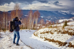 Photographer shooting landscapes Royalty Free Stock Image