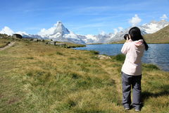 Photographer shooting Matterhorn Stock Image