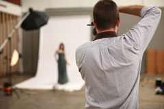Photographer shooting model Stock Photography