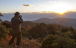 Photographer Shooting Mountain Sunset Stock Image
