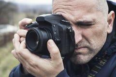 Photographer shooting outdoors scenery Stock Photos