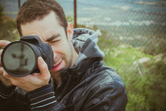 Photographer shooting outside with digital camera Royalty Free Stock Photos