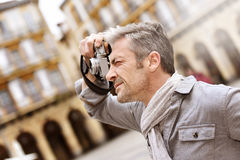 Photographer shooting photo of architecture. Man taking pictures on travel journey Stock Photo