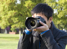 Photographer shooting photos Royalty Free Stock Image