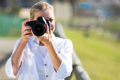 Photographer shooting photos Stock Photography