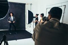 Model posing for a photograph during a photo shoot stock photos