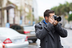 Photographer shooting photos Royalty Free Stock Photo