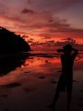 Photographer shooting seascape with twilight sky Stock Photo