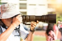 Photographer shooting soccer game. stock images