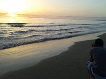 Photographer shooting at the sunrise on the beach Royalty Free Stock Photography