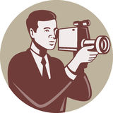 Photographer Shooting Video Camera Retro. Illustration of a male photographer shooting with video camera handycam video cam done in retro style set inside circle Royalty Free Stock Photography