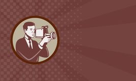 Photographer Shooting Video Camera Retro. Illustration of a male photographer shooting with video camera handycam video cam done in retro style set inside circle Royalty Free Stock Image