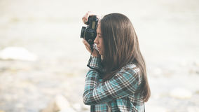 Photographer shooting. Young female photographer shooting, natural landscape on background Stock Images