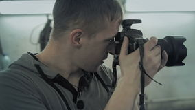 Photographer shoots in auto service stock footage