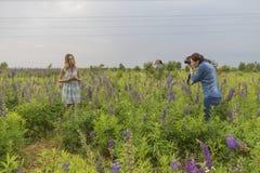 Photographer shoots Beautiful brunette fit slim fragile woman wi Stock Images