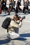 Photographer shoots report. Photo photographer to shoot a report about military parade Stock Photography