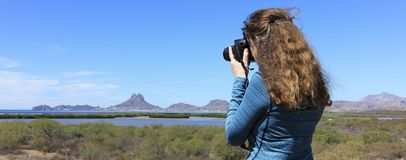 A Photographer Shoots Tetakawi Peak Rising Above San Carlos, the. Sea of Cortez and Soldado Estuary in Sonora, Mexico Stock Image