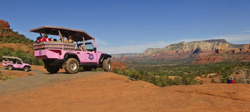 A Photographer Shoots a Tour Jeep in Sedona Stock Photo