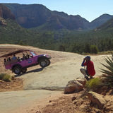 A Photographer Shoots a Tour Jeep in Sedona Royalty Free Stock Photos