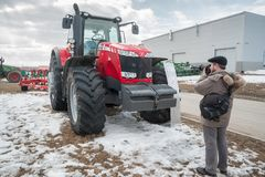 Photographer shoots tractor on exhibition Stock Photo