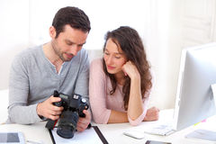 Photographer show results to his model Stock Photos