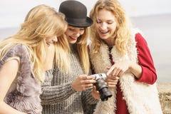 Photographer showing fashion models photos stock photography